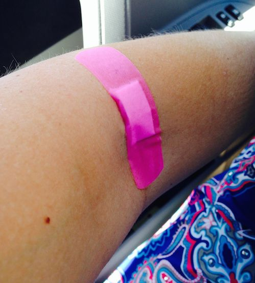 Blood Draw with a Pink Bandaid